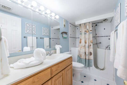 Guest bathroom with a handicap accessible tub/shower