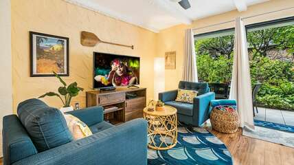 Living room with television and two tvs,