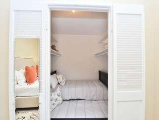 """Cozy and """"fort-like"""" perfect for the kids. Twin with a twin trendle in the walk in closet."""