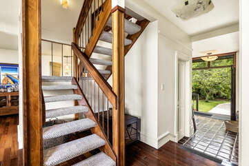 Townhome entrance and Stairs to Main suite bedroom and bedroom 2