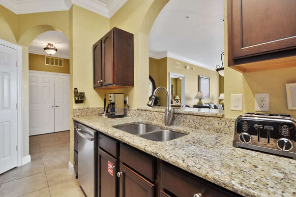 The kitchen features upgraded appliances and granite countertops