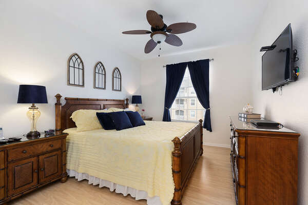 Master bedroom with king size bed, walk in closet overhead and ceiling fan