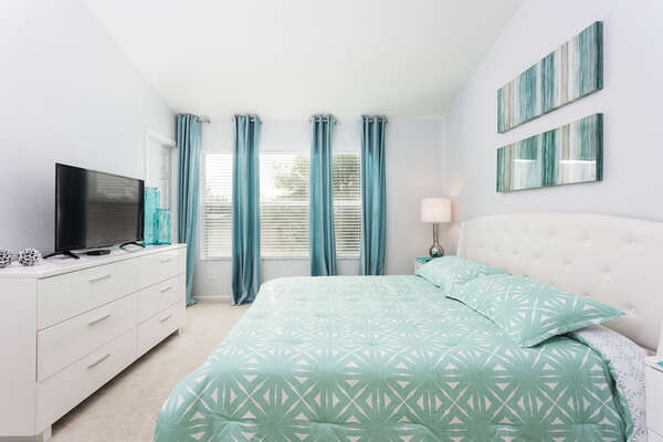 The second floor master bedroom is perfect for relaxing on vacation
