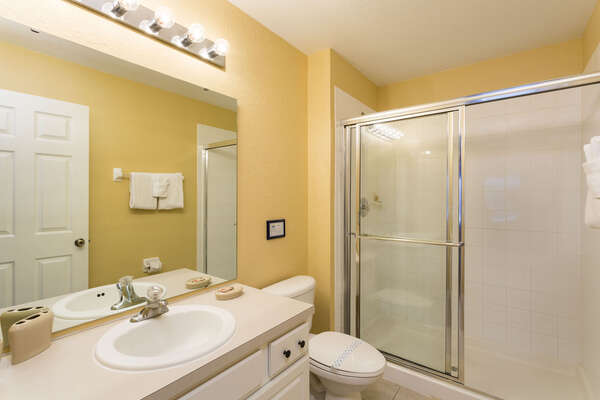 Gorgeous ensuite master bathroom with plenty of counter space and walkin shower