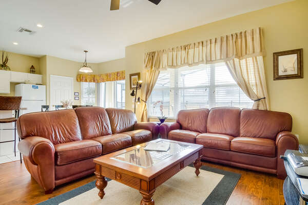 Plush leather couches and wood floors in the living room
