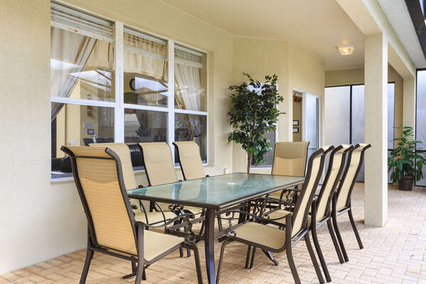 Enjoy a meal outside with this large dining room set with seating for 8