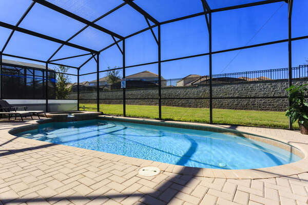 Enjoy the sunshine at your own screened-in pool