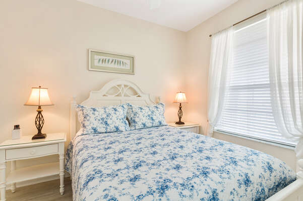 The third bedroom features a Queen bed