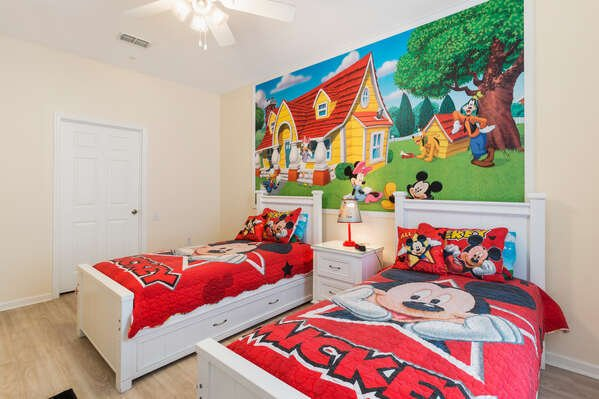Featuring two twin beds and awesome custom artwork