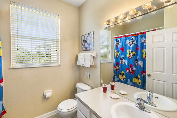 A shared family bathroom with shower/tub combination