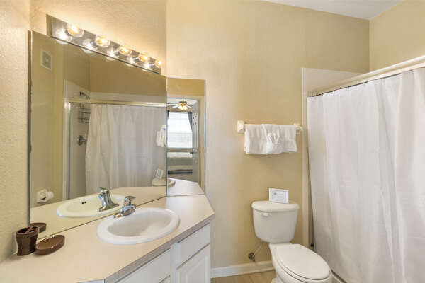 The ensuite master bathroom features plenty of space to get ready