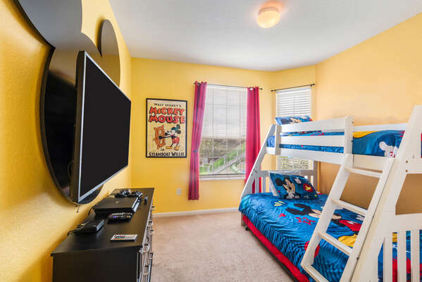 A bedroom just for the kids with a twin over full bunk bed