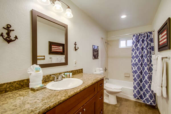Shower-Tub Combination, Toilet, and Single Sink Vanity.