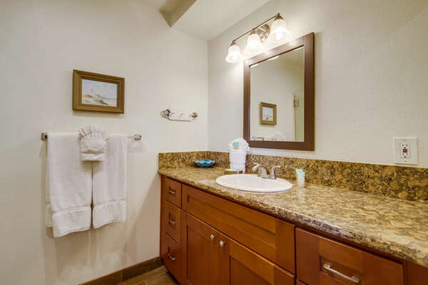 Single Sink Vanity with Mirror and Wall Lamp.