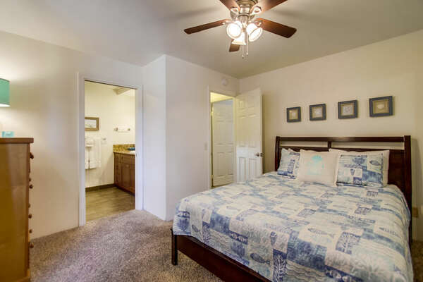 Bedroom with Large Bed, Dresser, and Ceiling Fan.