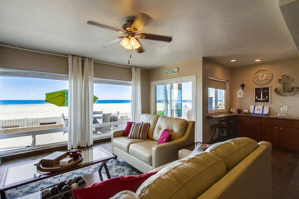 Two Sofas, Coffee Table, Ceiling Fan, Windows, and Sliding Doors.