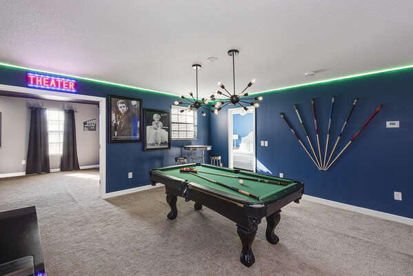 This loft area game room has access to the theater room as well
