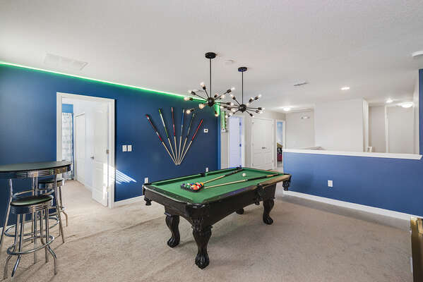 Play a game and hang out with family in this cool loft area game room