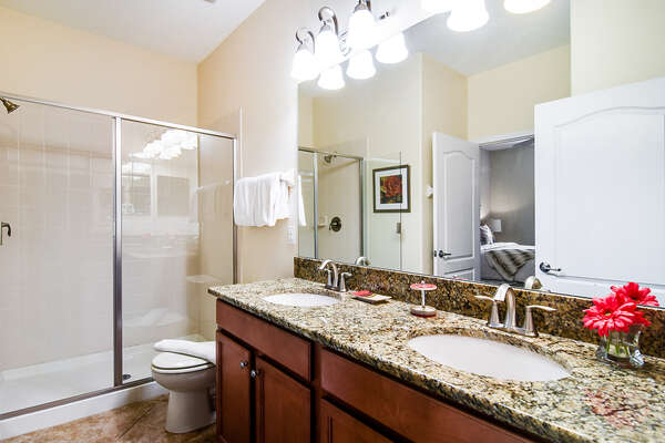 A Jack-n-Jill bathroom connects the bedrooms
