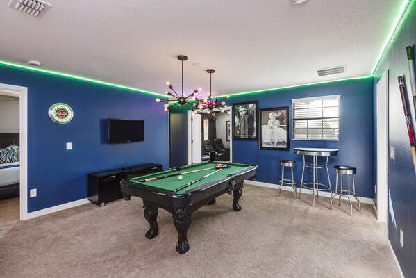 A loft game room with a pool table