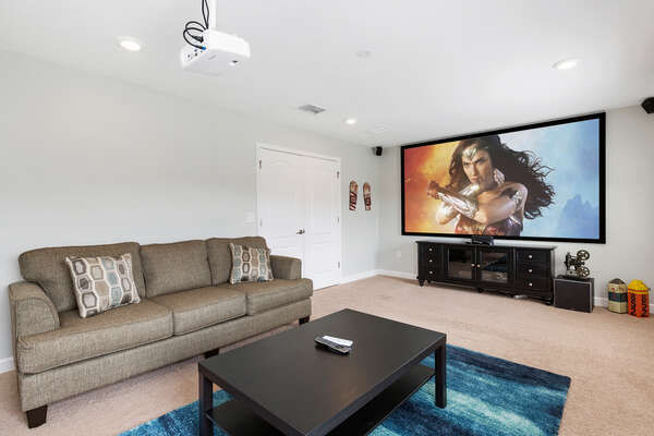 Host a movie night in the theater with the 120-inch projection screen and comfortable sofa seating