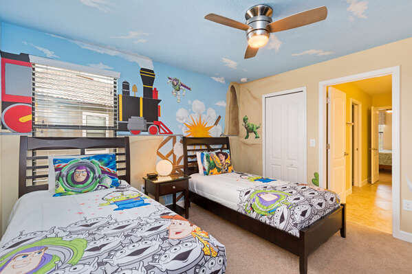 The kids will love to play big in their custom bedroom with two twin beds