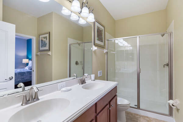 This bedroom has an en-suite bathroom with dual vanity and walk-in shower