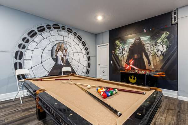 Everyone will love the fun custom design of the game room