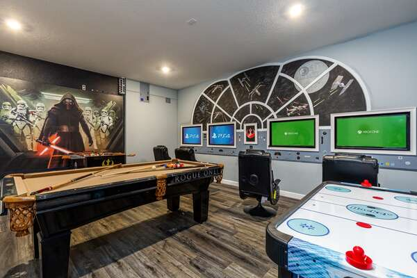 This fun game room features a pool table, foosball table and air hockey