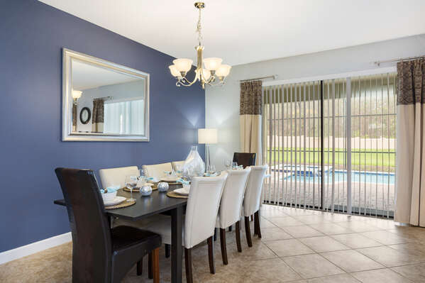 The formal dining table has seating for 10