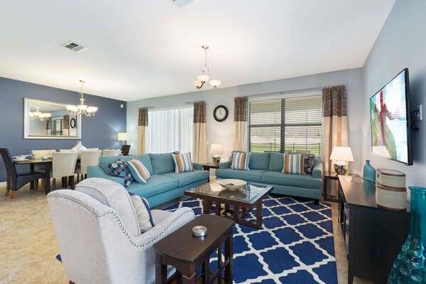 The living area has ample seating and a SMART TV