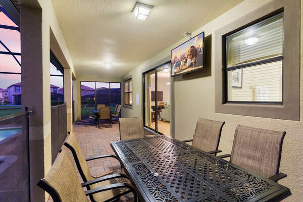 There are 2 tables with seating for 6 guests each underneath the covered lanai, in addition to an outdoor SMART TV