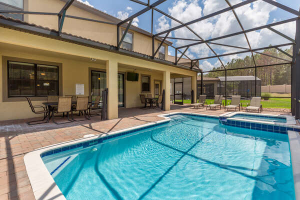 The pool has sun loungers and seating for outdoor seating