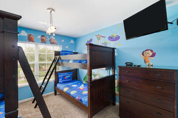 The kids bedroom features two twin over twin bunk beds and 43-inch SMART TV