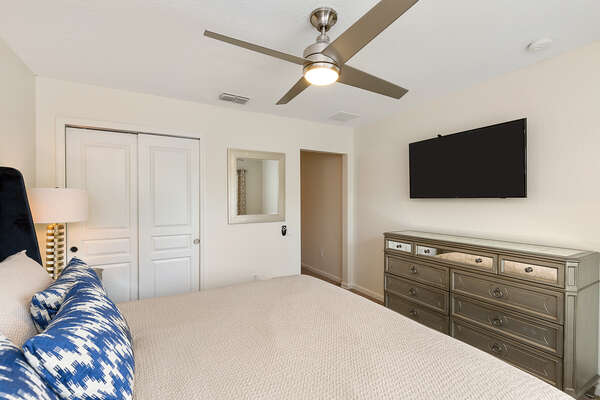The upstairs master suite features a 50-inch SMART TV
