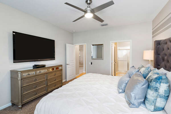 The master bedroom features a king bed on the ground floor with a  60-inch SMART TV