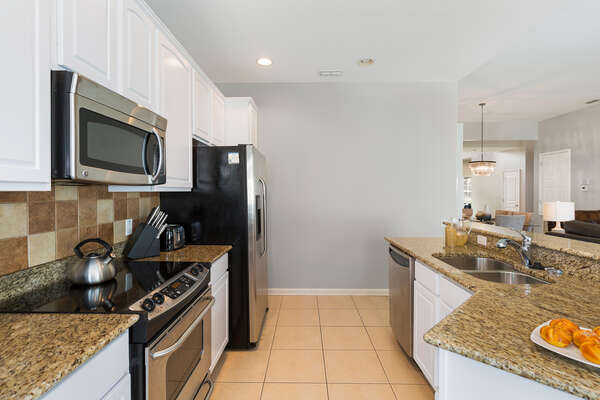 The kitchen has stainless steel appliances and granite counters
