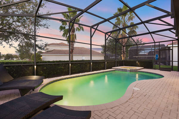 Enjoy your evening by the screened-in pool