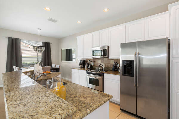 Prepare meals for the family in the fully equipped kitchen