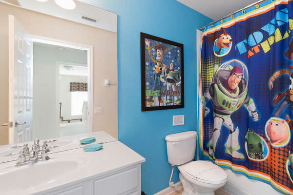 A family bathroom is located near the kids bedroom