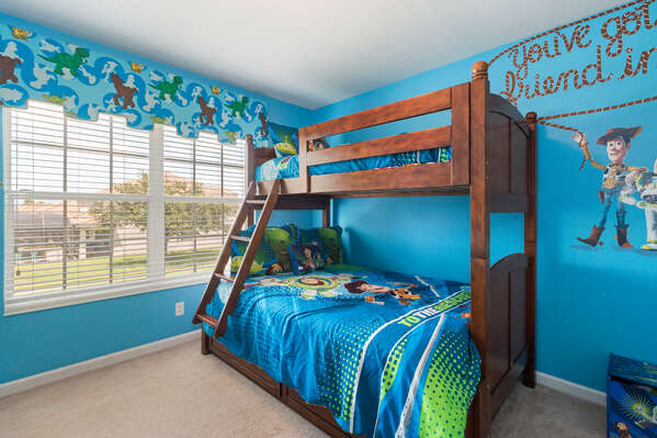 The kids bedroom features a twin over a full bunk bed