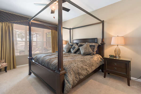 The ground floor master bedroom features a king bed and en-suite bathroom