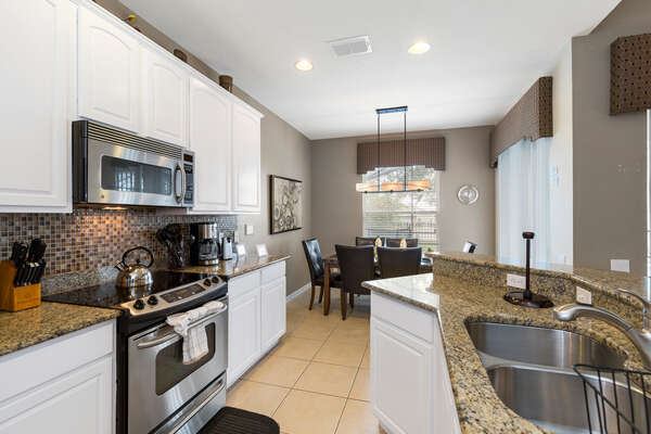 The kitchen is upgraded with granite counters and stainless steel appliances