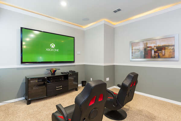 The games room has an 80-inch TV for you to enjoy as well