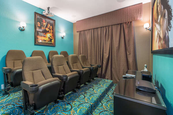 Watch your favorite movie and relax in the stadium style seating