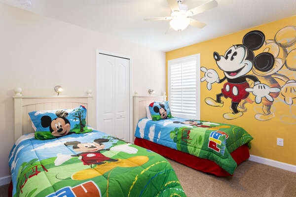 Kids will love this bedroom with two twin beds and their favorite character on the walls