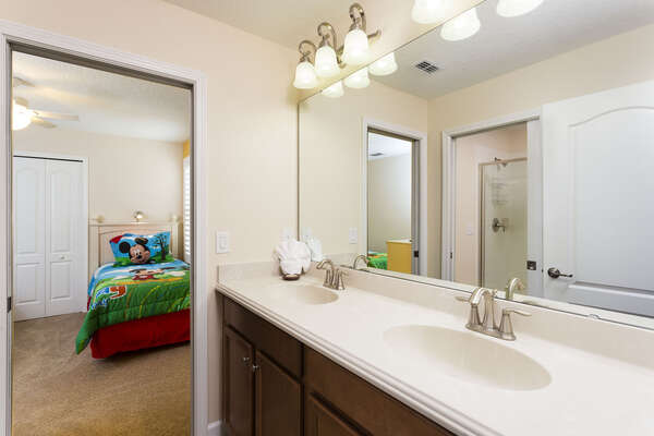 Jack-n-Jill bathroom connects the kids bedrooms