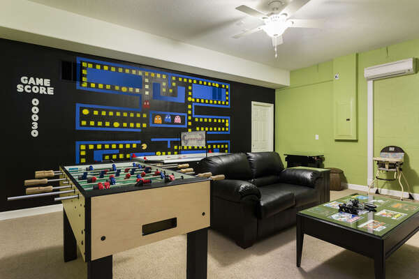 Play all day in the fun games room with a foosball table, comfortable seating, and flat screen TV to watch all your favorite shows. The air hockey table is no longer available in this room