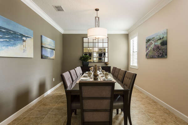 The whole family can enjoy meals together at the formal dining table with seating for 10