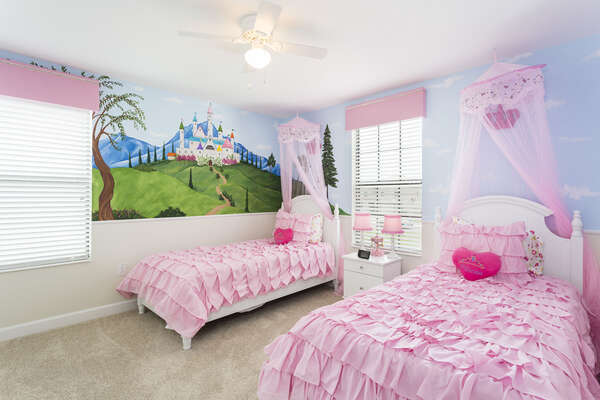 Princesses will love this bedroom with two twin beds, which even features hidden characters in the custom artwork